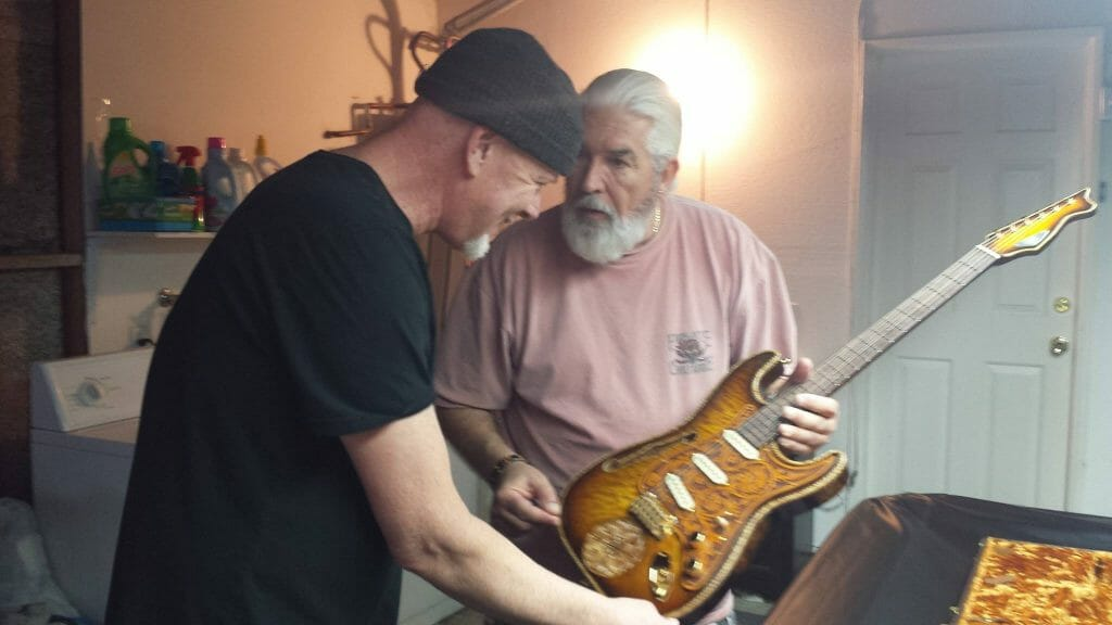 Mark Kendall of Great White receiving his RH Custom Guitar from Rick Harrison